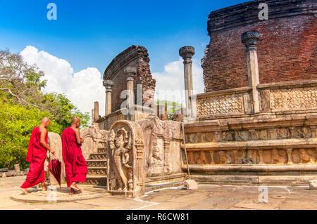 Monk Walking In Front Of Vatadage (Round House) Of Polonnaruwa Ruin Unesco World Heritage On Sri Lanka - Stock Photo