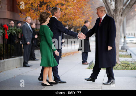 Washington, District of Columbia, USA. 4th Dec, 2018. Former first lady LAURA BUSH and former President GEORGE W. BUSH greet President DONALD TRUMP outside of Blair House. The Trumps were paying a condolence visit to the Bush family who are in Washington for former President George H.W. Bushs state funeral and related honors. Credit: Chip Somodevilla/Pool/CNP/ZUMA Wire/Alamy Live News
