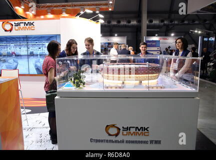 Yekaterinburg, Russia. 05th Dec, 2018. YEKATERINBURG, RUSSIA - DECEMBER 5, 2018: The Ural Mining and Metallurgical Company (UMMC) stand at the 100  Technologies International Forum for High-rise and Special Construction at the Yekaterinburg-Expo Exhibition Center. Donat Sorokin/TASS Credit: ITAR-TASS News Agency/Alamy Live News - Stock Photo
