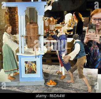 05 December 2018, Saxony, Leipzig: Christmas cribs and figures depicting the baroque everyday life of the southern Italian region around Naples can be seen in an exhibition in the Kunstkraftwerk. The Associazione Amici del Presepio di Napoli, the Naples Association of Crib Friends, presents the works of art in terracotta, cork, wax and ceramics. In contrast to many cribs in Europe, the more than 30 unique pieces, handmade by Neapolitan masters according to ancient tradition, do not focus on the holy family, but on everyday life in the 18th century and the fusion of the sacred and the profane. - Stock Photo