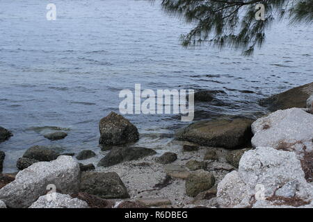 Rocks by the water in Tampa FL Stock Photo