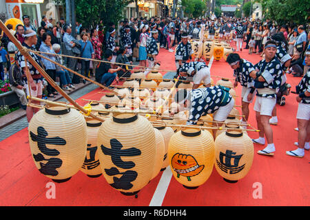 Lantern Poles Weighing Up To 60 Kilograms Are Balanced During The Kanto Matsuri Festival In Akita Tokyo Japan - Stock Photo