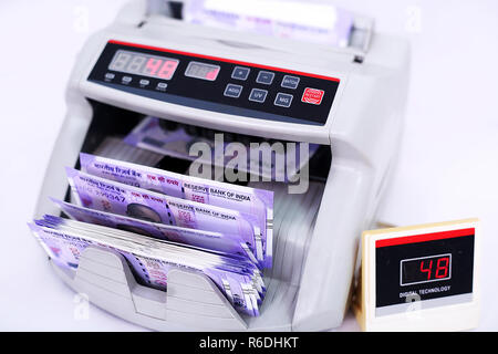 Money counting machine for Indian banknote machine. Isolated on the white background. - Stock Photo