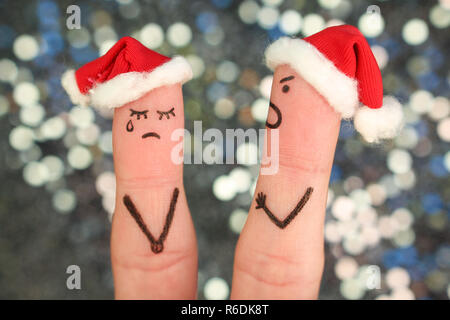 Fingers art of couple celebrates Christmas. Concept of man and woman during quarrel in New Year. - Stock Photo