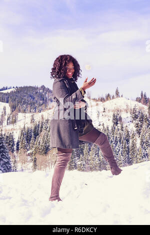 Fashionable Winter Clothing For Women Of Great Size And Good Mood With Snowball - Stock Photo