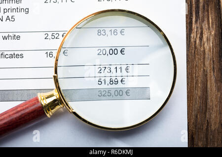 Magnifying Glass On Invoice - Stock Photo