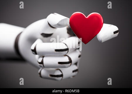 Robot Holding Red Heart - Stock Photo