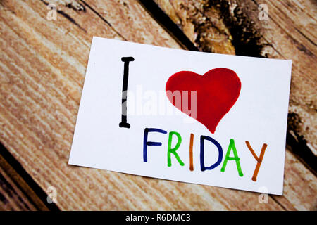 Hand writing text caption inspiration showing I Love Friday concept meaning Greeting Announcement Loving written on sticky note, reminder isolated background with space - Stock Photo