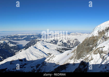 View from Jungfraujoch, Switzerland towards Wengen. Highest railway station in Europe 3,466 m (11,371 ft). Cloudless Sunny Winter day. - Stock Photo
