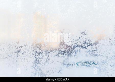 Ice pattern on the frosty window. Beautiful winter background. - Stock Photo