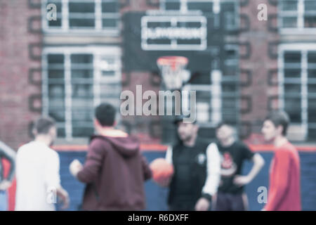 Street basketball. Youth, friends, play outside. Blurred background. Active lifestyle and sports among young people - Stock Photo