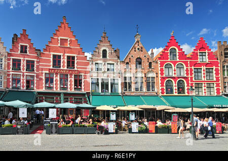 Medieval Style Shops And Restaurants Around The Market Place (Grote Markt) In Bruges Belgium - Stock Photo