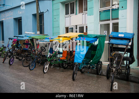Rickshaws lined up in Trinidad, Cuba. - Stock Photo