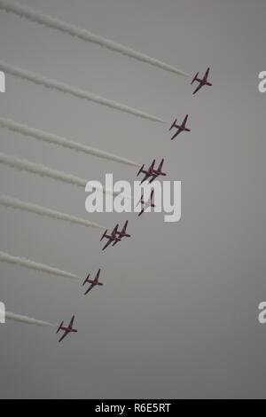The Red Arrows, Royal Air Force Aerobatic Team. Displaying at Sidmouth Regatta 2018, against a Moody Grey Sky. East Devon, UK. - Stock Photo
