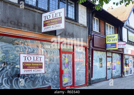 Empty shops to let, High Street, Ruislip, London Borough of Hillingdon, Greater London, England, United Kingdom - Stock Photo