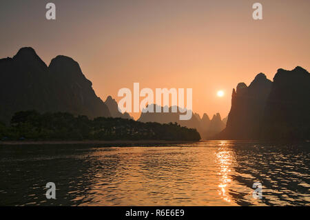 Scenic Sunset Over Karst Mountains Formations In Guilin, One Of China Most Popular Tourist Destinations - Stock Photo