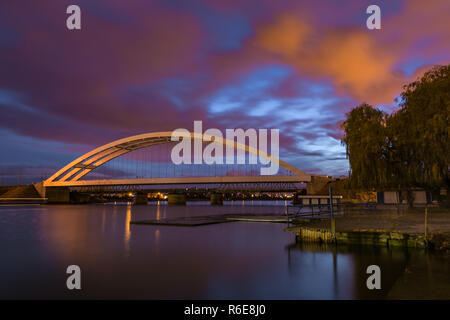 Railway bridge over Martwa Wisla river at night in Gdansk. Poland Europe. - Stock Photo