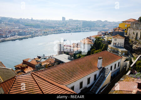Porto, Portugal - September 16, 2018 : On the banks of the river Douro the beautiful city of Porto and on the other bank the magificent city Vila Nova - Stock Photo
