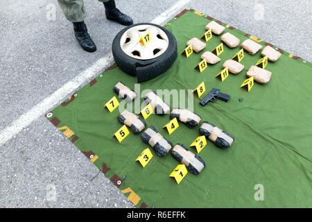Drug evidence seized during the police raid - Stock Photo