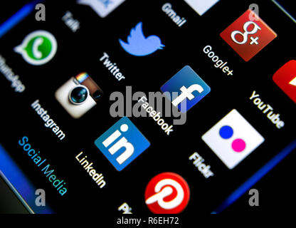 Facebook, Twitter, Instagram, Linkedin, Google, Flickr, Whatsapp, Youtube and other Popular social media icons on smart phone screen - Stock Photo