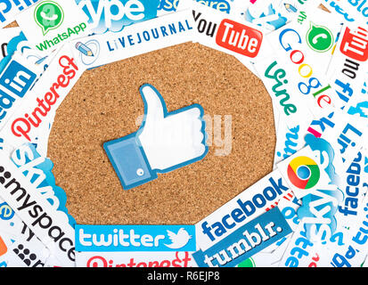BELGRADE - JUNE 17, 2014 Social media website logos Facebook Twitter and other printed on paper with like icon on cork bulletin board - Stock Photo