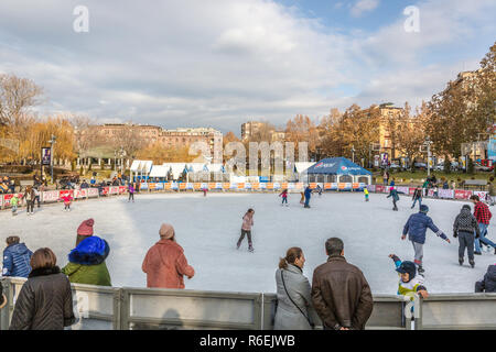 Yerevan, Armenia - Jan 8th 2018 - Tourists and locals enjoying an ice-skating park in Yerevan, winter time in Armenia - Stock Photo