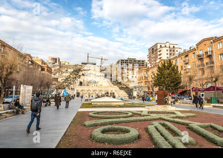 Yerevan, Armenia - Jan 8th 2018 - Tourists and locals in front of the Cascade and giant stairway in winter day - Stock Photo