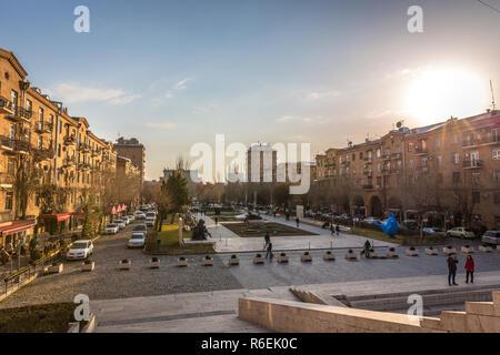Yerevan, Armenia - Jan 8th 2018 - Tourists and locals enjoying the sunset at the Cascade in Yerevan, Armenia - Stock Photo