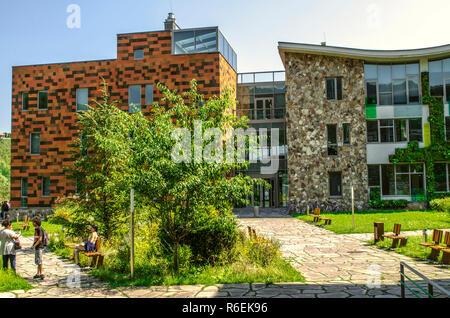 Dilijan,Armenia,August 24,2018:View from the garden to the glazed corridor connecting the administrative and educational buildings Of the  internation - Stock Photo