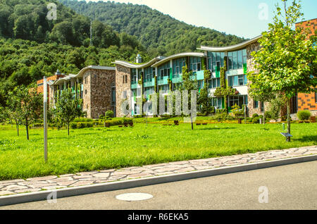 Dilijan,Armenia,August 24,2018: View from the road to the academic buildings at the International College in Dilijan, surrounded by forest - Stock Photo