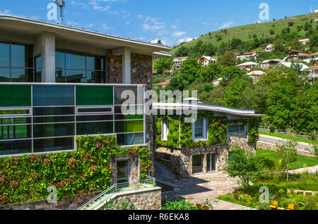 Dilijan,Armenia,August 24,2018: View of the hill with residential buildings and a highway passing  near the academic buildings of the International Co - Stock Photo
