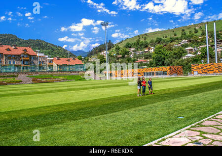 Dilijan,Armenia,August 24,2018:View of the football stadium and the international College student dormitory with Dilijan suburbs and private houses am - Stock Photo