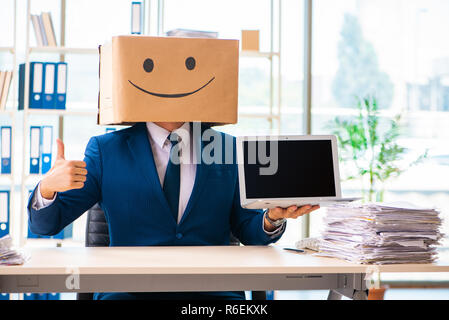 Happy man with box instead of his head - Stock Photo