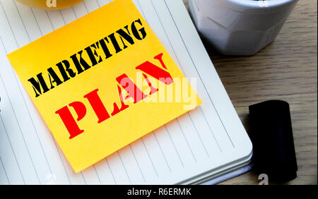 Writing text showing Marketing Plan. Business concept for Planning Successful Strategy written sticky note empty paper, Wooden background with copy space, Coffee and marker - Stock Photo