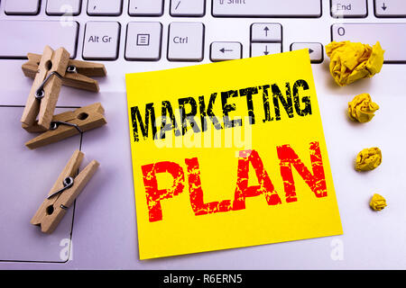 Hand writing text caption inspiration showing Marketing Plan. Business concept for Planning Successful Strategy written on sticky note paper on the white keyboard background. - Stock Photo