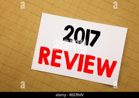 Conceptual hand writing text caption inspiration showing 2017 Review. Business concept for Annual Summary Report Written on sticky note yellow background. - Stock Photo