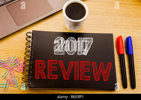 Handwriting Announcement text showing 2017 Review. Business concept for Annual Summary Report written on notebook book on the wooden background in the Office with laptop coffee - Stock Photo