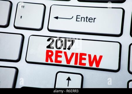 Writing text showing 2017 Review. Business concept for Annual Summary Report written on white keyboard key with copy space. Top view. - Stock Photo