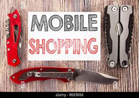Conceptual hand writing text caption inspiration showing Mobile Shopping. Business concept for Cellphone online order Written on sticky note wooden background with pocket knife - Stock Photo