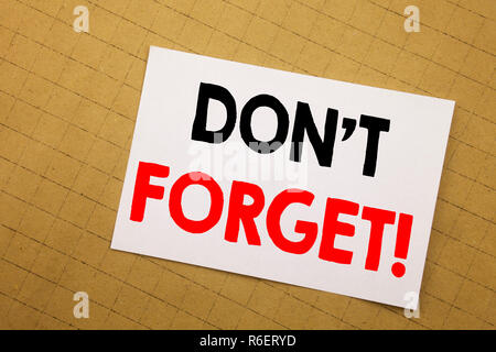 Conceptual hand writing text caption inspiration showing Do Not Forget. Business concept for Reminder Message Written on sticky note yellow background. - Stock Photo