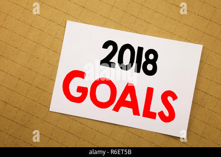 Conceptual hand writing text caption inspiration showing 2018 Goals. Business concept for financial planning, business strategy Written on sticky note yellow background. - Stock Photo