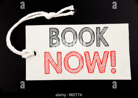 Handwritten text caption showing Book Now. Business concept writing for Reservation Booking written on price tag paper on the black vintage background.