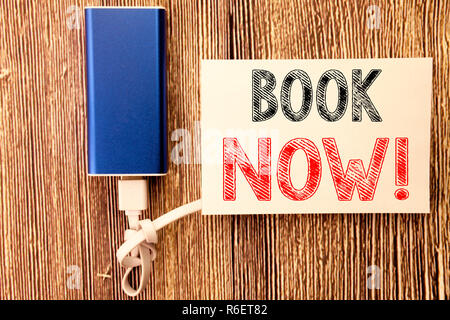 Conceptual hand writing text caption inspiration showing Book Now. Business concept for Reservation Booking written on sticky note old wood wooden background with power bank - Stock Photo