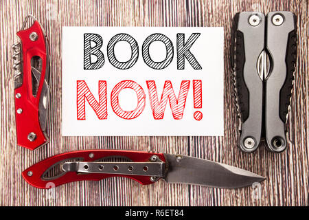 Conceptual hand writing text caption inspiration showing Book Now. Business concept for Reservation Booking Written on sticky note wooden background with pocket knife - Stock Photo