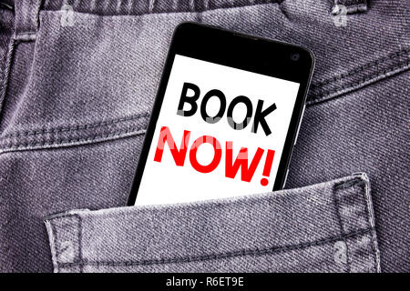 Conceptual hand writing text caption showing Book Now. Business concept for Reservation Booking written mobile cell phone with copy space in the back pants trousers pocket - Stock Photo