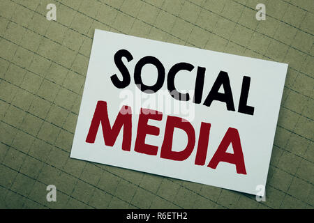 Conceptual hand writing text caption inspiration showing Social Media. Business concept for Community Social Media Written on sticky note yellow background. - Stock Photo