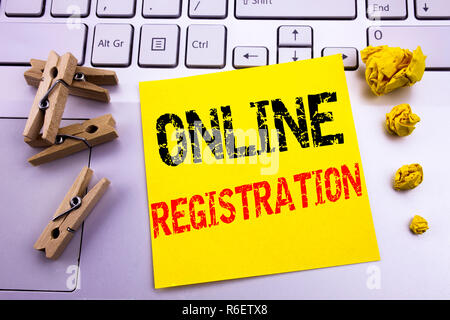 Hand writing text caption inspiration showing Online Registration. Business concept for Internet Login written on sticky note paper on the white keyboard background. - Stock Photo