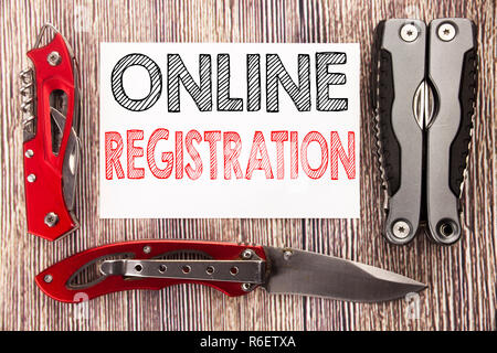 Conceptual hand writing text caption inspiration showing Online Registration. Business concept for Internet Login Written on sticky note wooden background with pocket knife - Stock Photo