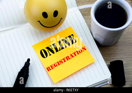 Writing text showing Online Registration. Business concept for Internet Login written sticky note empty paper, Wooden background with copy space, Coffee and marker - Stock Photo
