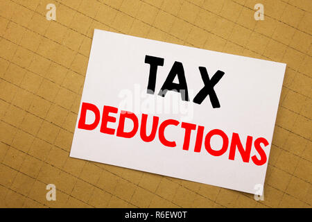 Conceptual hand writing text caption inspiration showing Tax Deductions. Business concept for Finance Incoming Tax Money Deduction Written on sticky note yellow background. - Stock Photo